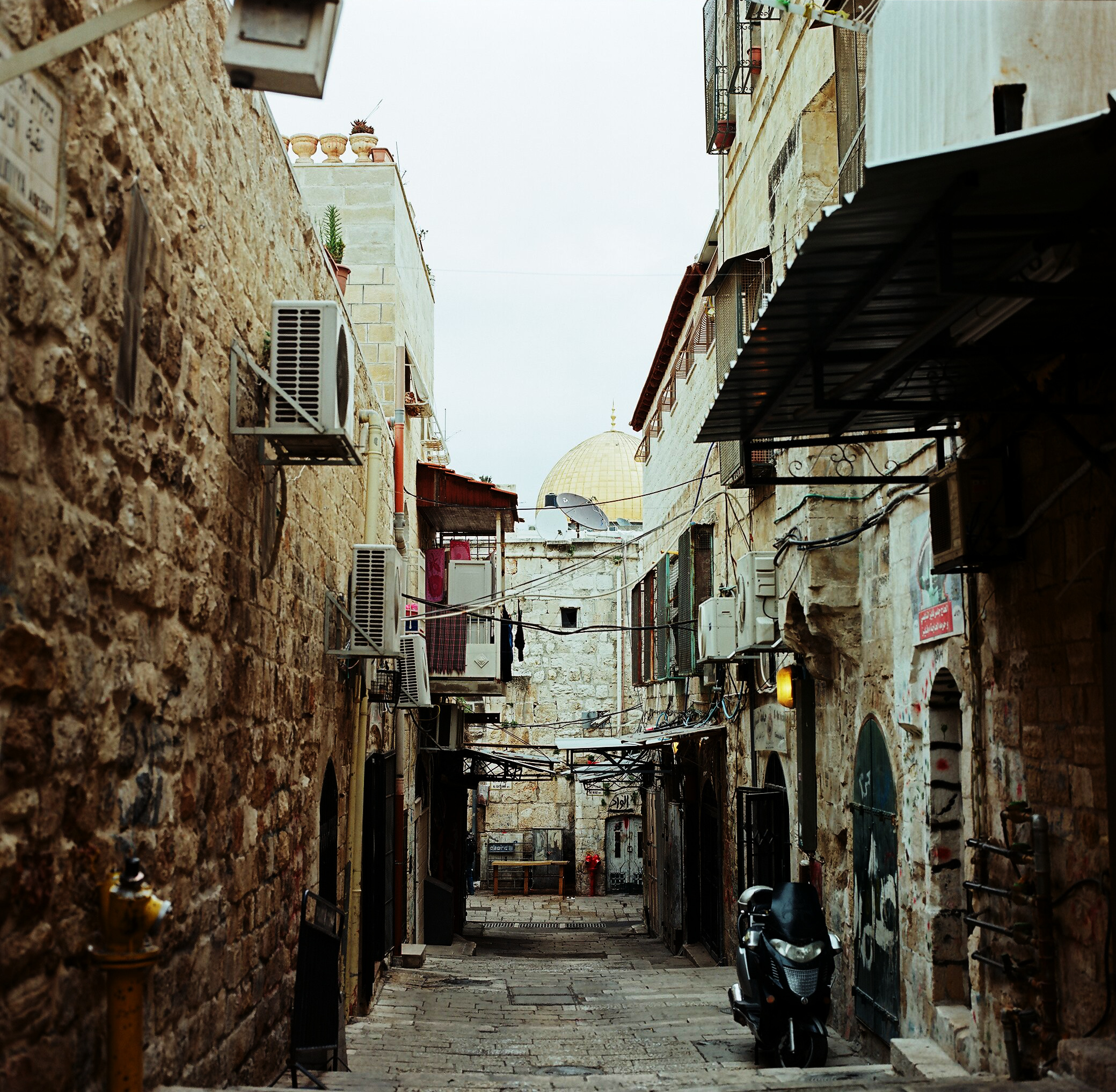 A street in Jerusalem with a view of the gold-plated Dome of the Rock.
