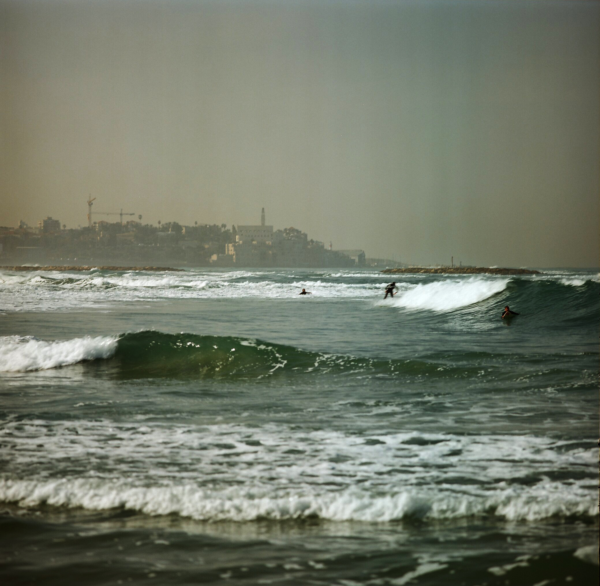 Surfers on Banana Beach, Tel Aviv.